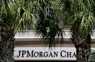 The front of one of the JPMorgan Chase & Co. buildings is shown during the annual meeting May 21, 2013, in Tampa, Fla. THE CANADIAN PRESS/AP, Chris O'Meara