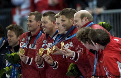 Team Canada's curlers (from left) Adam Enright, Ben Hebert, Marc Kennedy, John Morris and Kevin Martin show their gold medals.