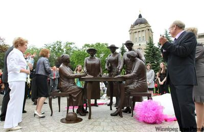 Sculptor Helen Granger Young (far left) is seen in 2010 at the unveiling of a statue of Nellie McClung and the 'Famous Five' who fought for women's suffrage at the Manitoba Legislature.