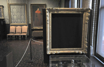 "FILE - In this Thursday, March 11, 2010 file photo, empty frames from which thieves took ""Storm on the Sea of Galilee,"" left background, by Rembrandt and ""The Concert,"" right foreground, by Vermeer, remain on display at the Isabella Stewart Gardner Museum in Boston. The paintings are among 13 works stolen by burglars from the museum in the early hours of March 18, 1990."