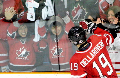 Team Canada's Stefan Della Rovere celebrates a third period goal with fans during semifinal world junior hockey championship action versus Team Switzerland in Saskatoon, Sask., Sunday. Team Canada won by 6-1.
