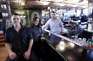 Riley Creighton (from left), GM of the Pint Public House, with assistant managers Melissa Ross and Garret Chapa.