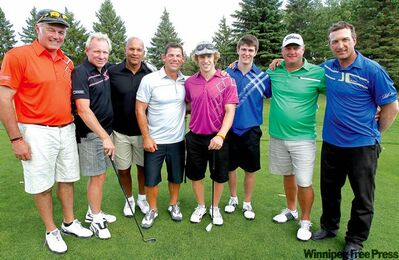 After taking part in the Dale Hawerchuk Charity Classic at Pine Ridge Golf Club Wednesday, new Winnipeg Jets Bryan Little (centre, purple shirt) and Mark Scheifele (to Little's left) hang out with former Jets (from left) Dave Ellett, Thomas Steen, Ray Neufeld, Kris King, Dave Manson and Dean Kennedy.