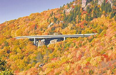 The Linn Cove Viaduct crosses fall foliage on the Blue Ridge Parkway in North Carolina.