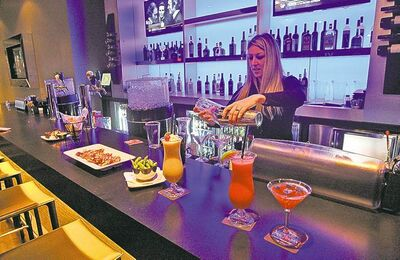 bar , bartender Leanne Dipucchio mixing drinks  with appetizers  - Odeon Cineplex   VIP  movie theatre McGillivray, Randall King  feature  KEN GIGLIOTTI  / WINNIPEG FREE PRESS  / Oct 30 2012