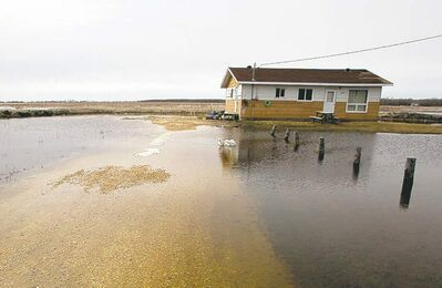 A home in Lake St. Martin surrounded by flood waters.