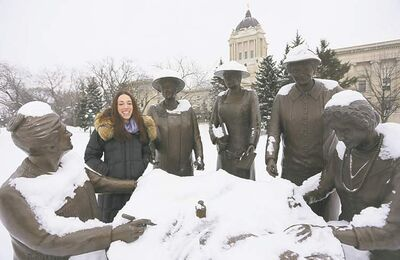 Winnipeg Free Press reporter Gabrielle Giroday  at the Nellie McClung statue at the legislature.