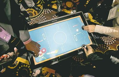 A game of air hockey is played on Lenovo's Table PC. It will go on sale this summer starting at US$1,699.