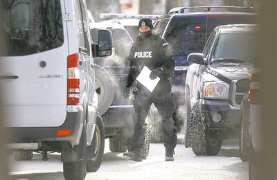 Phil Hossack / Winnipeg Free Press A standoff ended peacefully on Simcoe Street Friday.