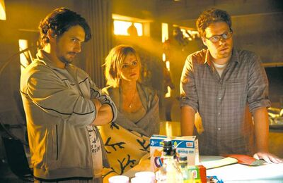 From left, James Franco, Emma Watson and Seth Rogen play themselves in This Is the End.