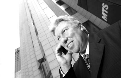 MTS Allstream CEO Pierre Blouin makes a call in front of the MTS building on Main Street.
