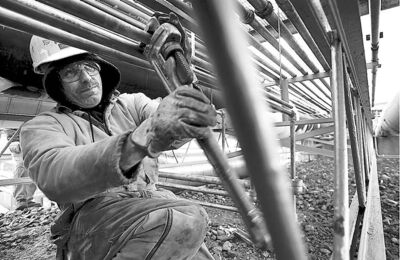 Electrician Dale Simonds uses a wrench while repairing electrical lines at the Distrigas liquid natural gas plant in Everett, Mass., March 20, 2006. Considered the first regulatory body for skilled trades in the country, the Ontario College of Trades has started registering members from 157 skilled trades.THE CANADIAN PRESS/AP-Steven Senne