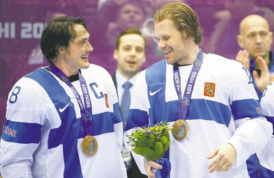 Julio Cortez  / The Associated PressFinns Teemu Selanne and Olli Jokinen share a chuckle after demolishing the Americans 5-0 on Saturday in the bronze-medal game.