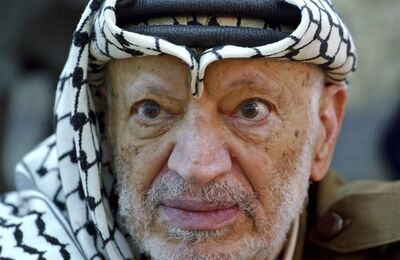 FILE - In this Saturday, Oct. 2, 2004 file photo, Palestinian leader Yasser Arafat pauses during an emergency cabinet session, at his compound, in the West Bank town of Ramallah. Palestinian official says the remains of former Palestinian leader Yasser Arafat will be exhumed on Tuesday, Nov. 27, 2012 to enable foreign experts to take samples as part of a probe into his death. (AP Photo/Muhammed Muheisen, File)