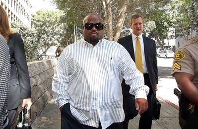 Entertainer Cee Lo Green leaves Los Angeles Superior Court after a hearing Friday, Aug. 29, 2014. Green pleaded no contest to giving a woman ecstasy during a 2012 dinner in Los Angeles. Green, whose real name is Thomas DeCarlo Callaway, was sentenced to three years of probation and 360 hours of community service. (AP Photo/ Nick Ut)
