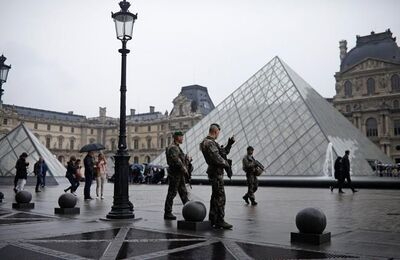 Soldiers patrol in the courtyard of the Louvre museum in Paris, France Sunday, May 7, 2017. French presidential candidate Emmanuel Macron's press office said that the Esplanade du Louvre, where the centrist candidate plans to celebrate if he wins the French presidential election was earlier evacuated after a security alert.(AP Photo/Kamil Zihnioglu)