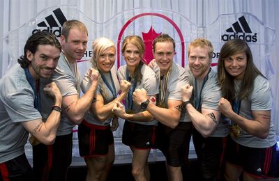 Canadian winter Olympians (left to right) Charles Hamelin, Chris Del Bosco, Kaillie Humphries, Meaghan Mikkelson, Erik Guay, Jon Montgomery and Maelle Ricker pose for a photo at an event announcing the sponsorship of the team by Adidas in Toronto on Tuesday June 25, 2013. THE CANADIAN PRESS/Frank Gunn