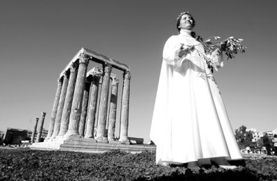 Petros Giannakouris / the associated press archivesA priestess holds an olive-tree branch as she participates in a ceremony honouring Zeus, the king of the ancient Greek gods, at the Temple of Olympian Zeus in Athens.