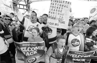 Hundreds of fans scream under the canopy at The Forks Tuesday to celebrate the NHL's return.