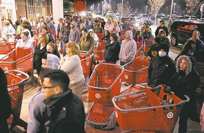 A crowd of shoppers waited outside the Target store in Lisbon, Conn., before it opened at midnight.