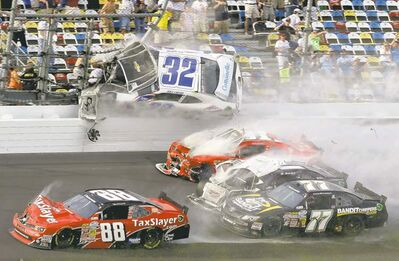 John Raoux / the associated pressKyle Larson (32) goes airborne into the catch fence in a multi-car crash during the final lap of the NASCAR Nationwide Series race at Daytona.