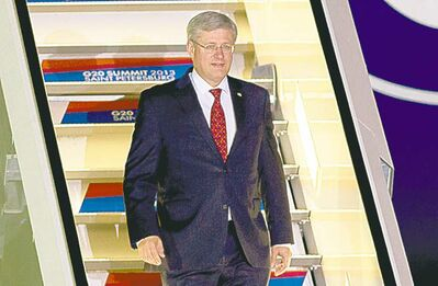 Prime Minister Stephen Harper arrives in St. Petersburg, Russia, Wednesday for the G20 summit.