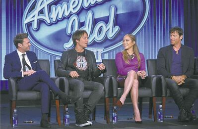 From left, host Ryan Seacrest, and judges  Keith Urban,  Jennifer Lopez, and Harry  Connick Jr.  talk to reporters about the  new season  of American Idol.
