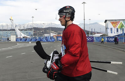 Canada's men's captain Sidney Crosby walks from hockey practice in the warm weather to the teams dressing room on Wednesday. Current GM Steve Yzerman has worked to bring the best players of the moment to Sochi, but in doing so he's got a very young leadership group. Captain Crosby is just 26 and his alternates Shea Weber and Jonathan Toews are also under 30.