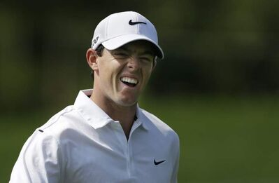 Rory McIlroy, of Northern Ireland, reacts on the 17th hole during a practice round for the PGA Championship golf tournament at Oak Hill Country Club, Wednesday, Aug. 7, 2013, in Pittsford, N.Y.