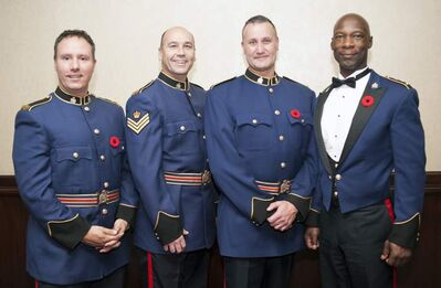 Const. Shaun Chornley (left), Sgt. Geordie MacKenzie, Const. Kevin Gibson and Police Chief Devon Clunis.