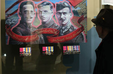 A man looks at the exhibit of The Victoria Cross Medals of recipients Corporal Lionel Clarke, Sergeant Major Frederick Hall and Lieutenant Robert Shankland  displayed at the National War Museum in Ottawa.
