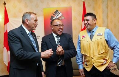 Grand Chief Ron Evans of the Assembly of Manitoba Chiefs, center, beams, as he, John Duncan, Minister of Indian Affairs and Northern Development, and Atlantic Policy Congress co-chair Chief Morley Googoo of Nova Scotia confer following the federal government announcement for support for a better electoral system for First Nations at a news conference in Halifax, on Friday Oct. 1, 2010.