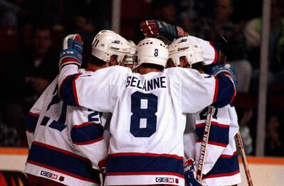 Teemu Selanne celebrates a goal with his Jets teammates before he was traded to the Anaheim Ducks in 1996.