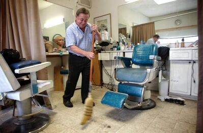 Rocco 'Rocky' Curatola, 74, has been cutting mens hair in his barber shop for well over 40 years.