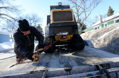 Tim Winnicky spent time removing snow from an alley between Fleet and Waterloo in River Heights, Friday, March 14.