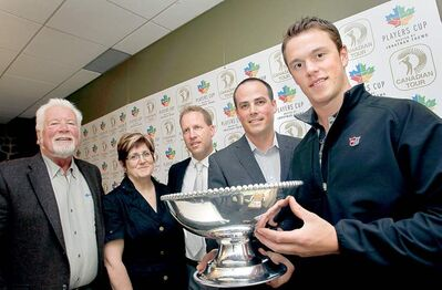 WAYNE.GLOWACKI@FREEPRESS.MB.CA  Chicago Blackhawks captain Jonathan Toews (far right) holds the Players Cup Thursday. To his right are Ryan Hart, executive director of the Players Cup, Jason Ludke, Pine Ridge GM, Chris Schollenberg of the Children�s Rehabilitation Foundation and Aidan O�Brien of the St. Boniface Hospital Foundation.