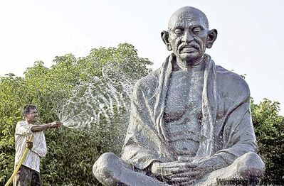 A worker cleans a statue of Mahatma Gandhi  in Bhubaneshwar, India.