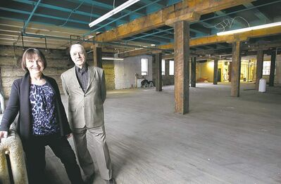 WAYNE GLOWACKI / WINNIPEG FREE PRESSLeasing agent Joe Diner and Barbara Lapointe of United Equities Group inside 111 Lombard. Both believe heritage buildings, properly renovated, are in a class of their own and will draw tenants.