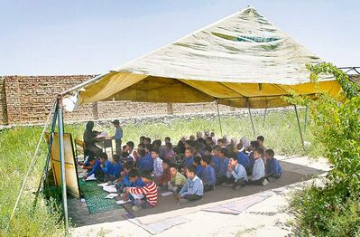 MUSADEQ SADEQ / THE ASSOCIATED PRESSAfghan students take mid-year exams under a tent at the Mirbachakot high school on the outskirts of Kabul.