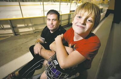 John Woods / Winnipeg Free PressDonovan Cox, 10, with his dad, Jesse Cox. Jesse and his family had a terrible scare after Donovan suffered a head injury while skateboarding.