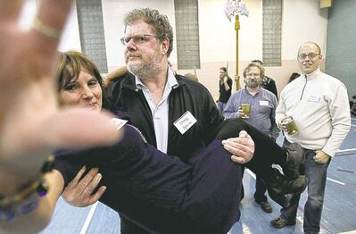 Mike Deal / Winnipeg Free PressCourtier Doug Speirs picks up Bonita Reimer, a woman of the court, during a rehearsal for Rigoletto.