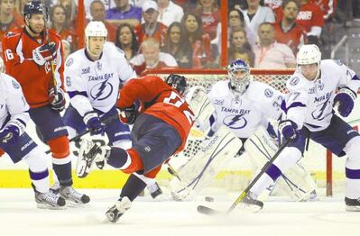 Mitchell Layton / MCTCapitals defenceman Mike Green (52) puts the winner in the net in overtime against the Lightning at the Verizon Center in Washington, D.C., Saturday.