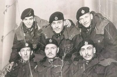 Stanley Jaworski (bottom centre) with his tank crew from Lord Strathcona's Horse armoured regiment. They lost a tank to a direct hit in the Korean War, Jaworski says.