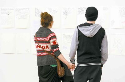 Students read a wall of condolence at Alberta College of Art and Design.