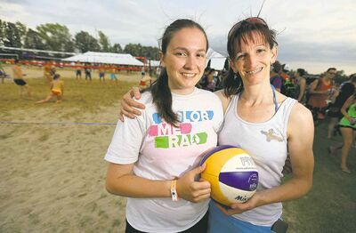TREVOR HAGAN / WINNIPEG FREE PRESSMica Rosier, 19, and her mom, Rona, enjoy the vibe at the Super Spike volleyball tournament Friday at Maple Grove Rugby Park.