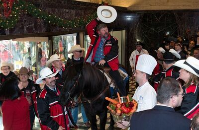 Fletcher Armstrong, with the Calgary Grey Cup committee, rides his horse, Marty, in the front foyer of the Royal York hotel Thursday, Nov. 22, 2012 in Toronto. Calgary Stampeders will play the Toronto Argonauts in the Canadian Football League Grey Cup Sunday, Nov. 25, 2012. THE CANADIAN PRESS/Sean Kilpatrick