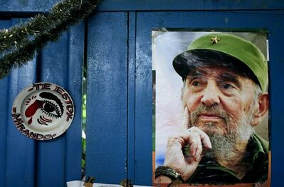 "A poster of Cuba's Fidel Castro hangs on the wall of a food market next to plate that reads in Spanish ""I'm looking at you"" in Havana, Cuba, Tuesday, Aug. 13, 2013. Castro turns 87 on Tuesday. Castro's brother Raul Castro has been in power since a near-fatal illness forced Fidel to step aside in 2006. (AP Photo/Franklin Reyes)"