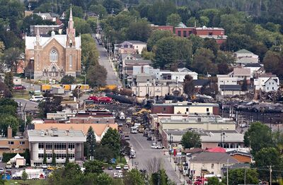 The Sainte-Agn�s Catholic Church stands unscaved next to the derailment and blast site in Lac-Megantic, Que., Tuesday, July 9, 2013. Pope Francis extended an apostolic blessing to victims, families and everyone affected by the tragedy on Tuesday. THE CANADIAN PRESS/Jacques Boissinot