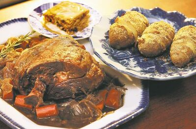 Slow roast lamb, Hasselback potatoes and sticky toffee pudding
