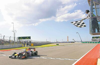 Red Bull driver Sebastian Vettel of Germany crosses the finish line Sunday to win the Formula One U.S. Grand Prix auto race at the Circuit of the Americas.